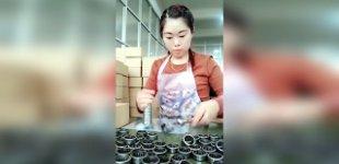 Asiatische Handarbeit verpacken Lager