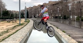 Cyclist Jump Across River