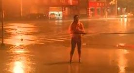 Reporterin live im Taifun