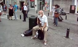 Old Guy rock in pedestrian area
